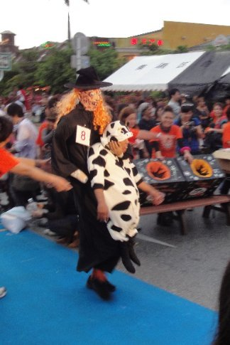 Witch carrying cow with human head...a bit creepy, if you ask me.