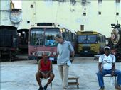 Men working in a parking of old and useless bus in La Habana.: by aliciafabregas, Views[117]