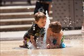 Children were having fun with the water fountains in the streets of Glenleg Beach area, Adelaide.: by arefin, Views[59]