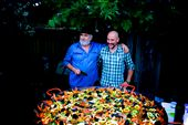 The paella man's apprentice. Delicious paella being served by these two.: by benkelly, Views[111]