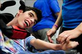 Even disability does not stop this young man from using his facial muscles to laugh and smile.: by cattack, Views[255]
