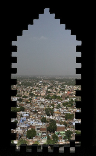 view of the city through a window at a nearby Fort.  This is the queen's room, like all queens of Medieval India, she had many restrictions on her freedom and life.