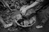 Pieces of coal and loading into wicker baskets for sell at black market.: by eztosee, Views[314]