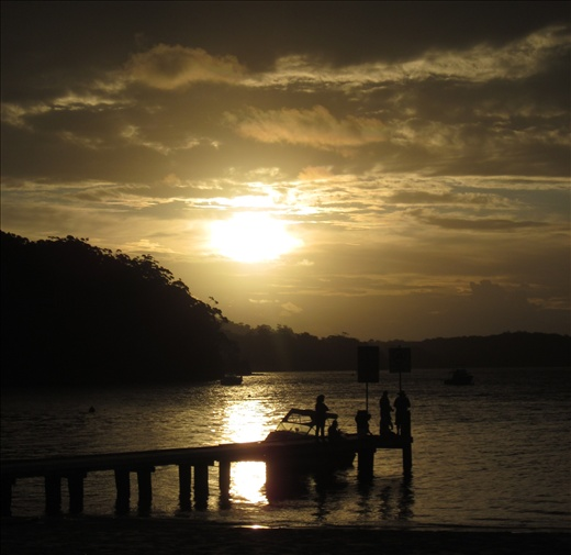 A positively great photo of a beautiful sunset over Little Beach in Nelson Bay