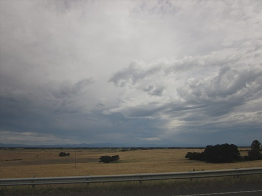 A typical sky looms over the Gippsland flatlands looking toward the High Country