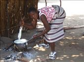 local lady making ugali..staple food for africans (like rice thats been very overcooked & become the consistancy of playdough): by hope_brian, Views[311]