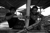 Saiful (right) and his friend were relaxing before going to the sea. His a young fisherman with dark experiences from the sea. Two times imprisoned for illegal fishing in Northern Territory, Australia, not make him stop going to be a fisherman. Fishing is the only skill he has have. : by iamdreamcatcher, Views[64]