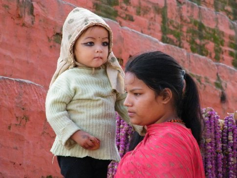 India and Nepal -- highlighting the eyes of young children with kohl