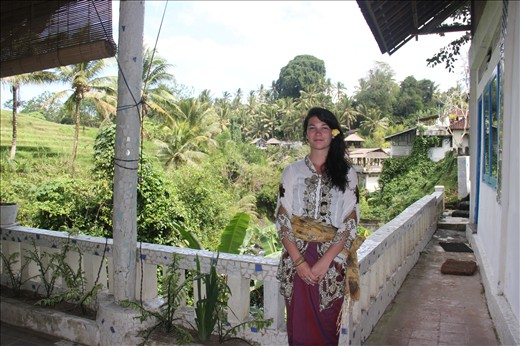 In traditional Balinese dress