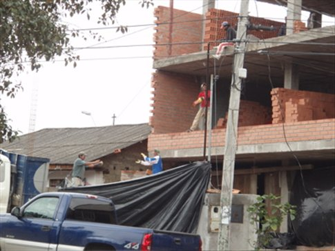4 men and lots of bricks to move.  Cuenca Ecuador
