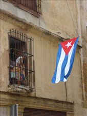 It has been fifty years since the victory of the Cuban revolution. Havana - the city and the people - do not seem to have changed much. In this picture a woman