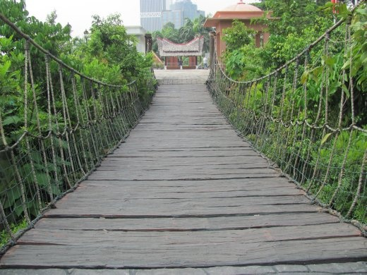 Wooden swing bridge going into the cultural village at the for Wooden swing set with bridge