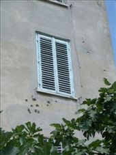 Evidence of the war still remains in Zadar in some places. You have to wonder what happened to the person who must've been standing or peering from this window to attrack the attention of enemy fire.: by maria_brett, Views[492]