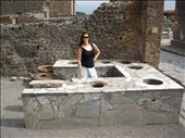 Tracey behind the counter of a 1,900 year old snack bar/restaurant ready to serve.  The food was put in urns that sat in the holes on the counter. : by morter_family, Views[147]