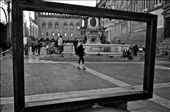 A woman walks with confidence past the Fountain of Neptune in Bologna, Italy. Italians are known for their innate sense of style and fashion in all walks of life. : by mprokosch11, Views[65]