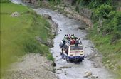 This is photo of a bus overloaded and its rainy season the way turned into rive rbut nothing stops.: by photo-nature, Views[259]