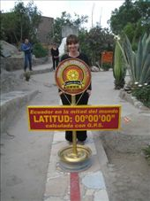Me looking like an even bigger dork standing on the real equator line, just down the road at the Museo Inti-Nan (this was just before I balanced an egg on a nail head): by ranizo, Views[157]
