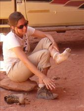 Heather emptying her shoes of a LOT of red sand: by shrummer16, Views[157]