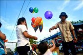 a mother bought a ballon for her child at rail market at sunter north jakarta: by siscaangie, Views[30]