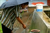 """Imsak, 27 year old, a young villager from Semanu, Gunungkidul, took a """"wudhu"""" or an Islamic ritual before praying. He used the water from a reservoir tub held rainwater during the wet season.: by tranquillity, Views[89]"""